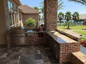 Outdoor, Kitchen, With, Bricks, And, Natural, Stone, Countertops