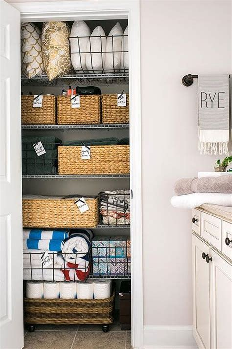 organized linen closet transitional bathroom