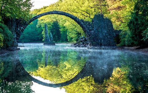 arch lake rock stone trees forest reflection hd wallpaper