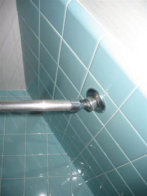 how to install a shower rod in a shower with a sloped