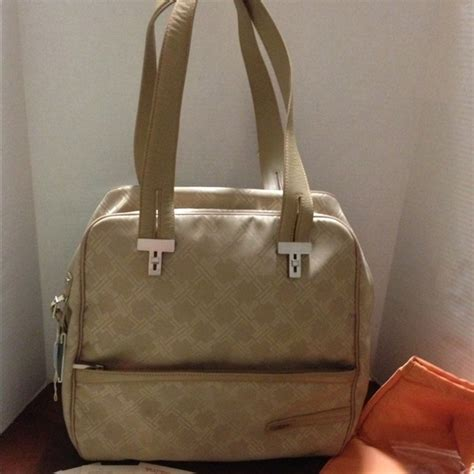 tumi handbags  tumi monogram signature women