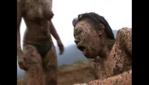 Two Asian Girls Wrestling On Manure Field