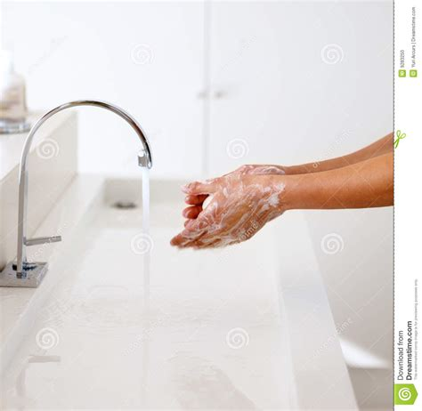 person washing hands   tap stock photo image
