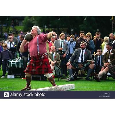 Scottish man wearing kilt putting the shot at Royal
