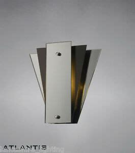 stylish art deco wall light with mirror and glass panels