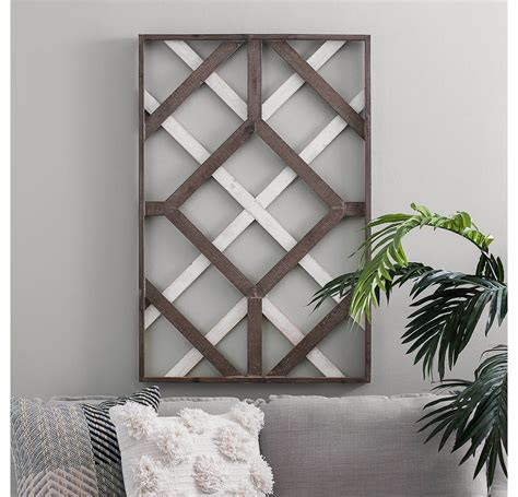 This diy wall decor project is easy, quick, cheap and oh so lovely. Two-Tone Geometric Wood Wall Plaque in 2020 | Diy wood wall, Wood wall decor, Metal tree wall art