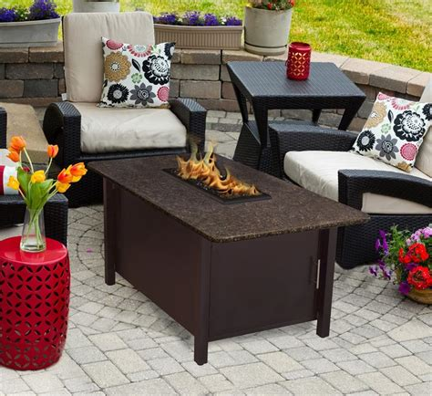 Fire pit tables come in different styles including patio tables with fire pits, dining tables, coffee tables, rectangular tables, round tables and square the endless summer gas outdoor fire pit table is constructed from sturdy steel, making it durable and able to handle harsh weather conditions. Outdoor Fire Pit Coffee Table Carmel Chat Height with American Fire Glass
