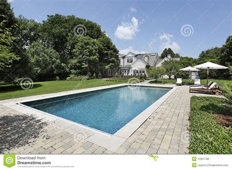 swimming pool with deck chairs royalty free stock photos