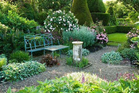 Formal Garden With Blue Painted Wrought Iron Bench, Old