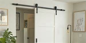 barn style sliding doors how why to get the look With barn style bifold doors