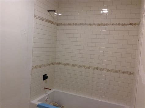 shower tile is up no grout yet and no bullnose pieces on