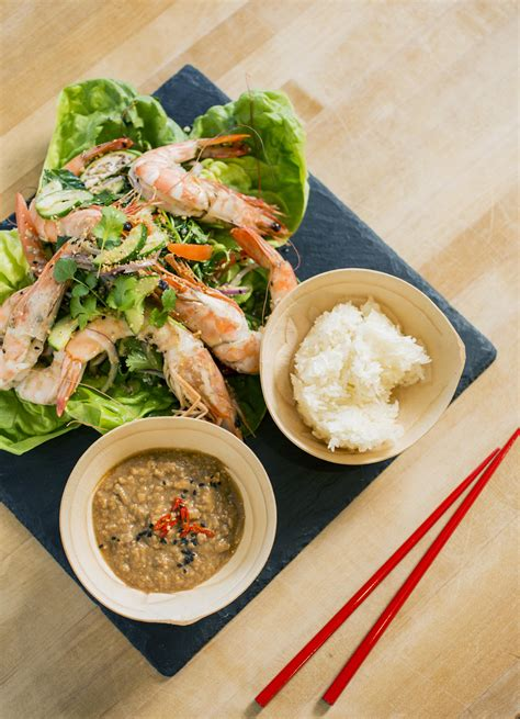 Hot shrimp with smooth avocado and crunchy cucumber, combined with a delicious ginger and garlic dressing. Spicy Thai Shrimp Salad | Asian recipes, Seafood recipes, Spicy thai