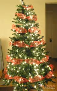 how to decorate a christmas tree with wide mesh ribbon the organized dream