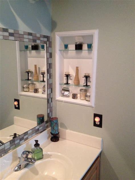 Framed medicine cabinet & tile around standard mirror