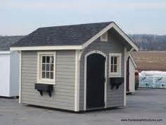 this is an 8x10 shed with cedar siding with a sliding door With 8x10 garage door