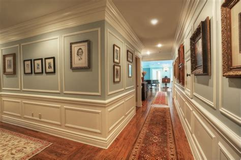 traditional hallway with crown molding chair rail in