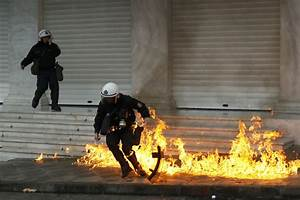 Anti-austerity riots across Athens send shoppers fleeing ...
