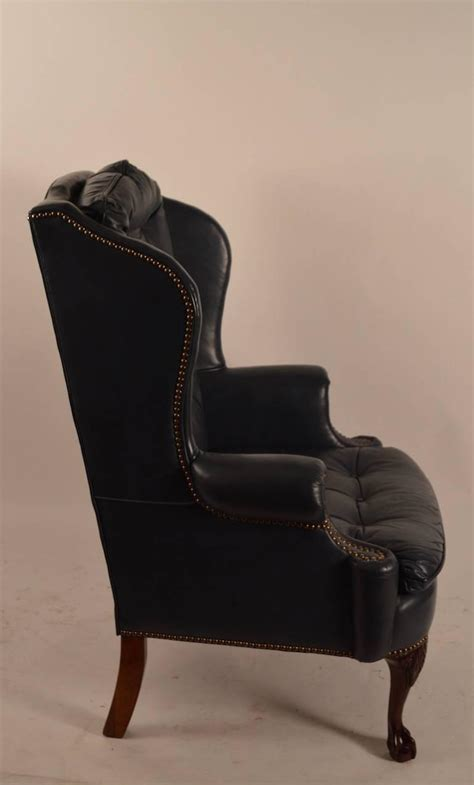 midnight blue leather wing chair with cabriole leg for