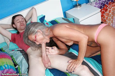 Glasses Adorned Granny Sucks And Tugs On A Younger Mans