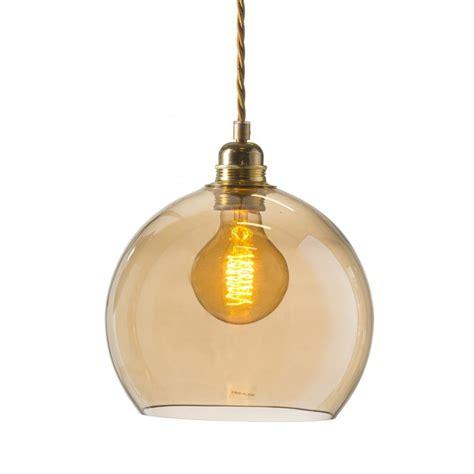 small golden smoked glass globe pendant light on gold
