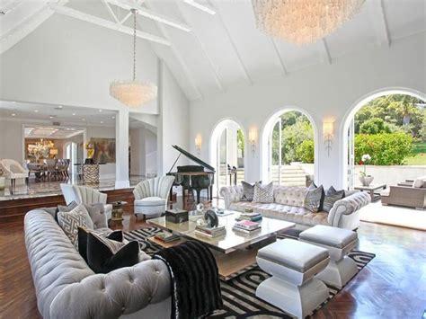 glamorous living room gray tufted sofas interior design