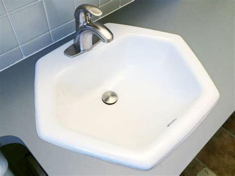 modern bathroom faucet meets  vintage hexagon sink