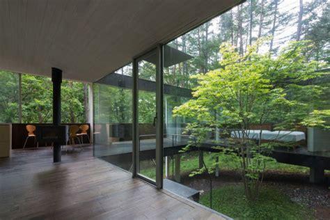 center courtyard house plans singular tree grows through center of modern home in japan
