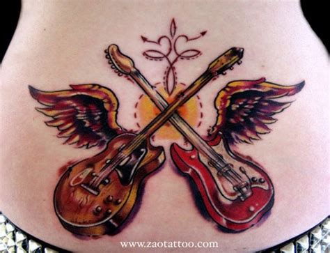 Winged Cross Red And Brown Guitar Tattoo On Lowerback