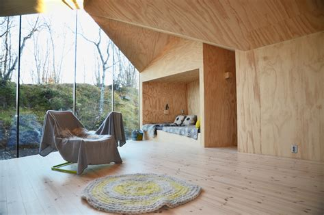 reiulf ramstads  lodge serves   timber retreat  norway
