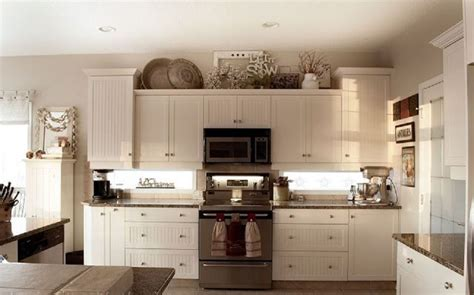 Decorating Ideas For Kitchen Cabinet Tops by Decor On Top Of Cabinets Accessories Decorating Above