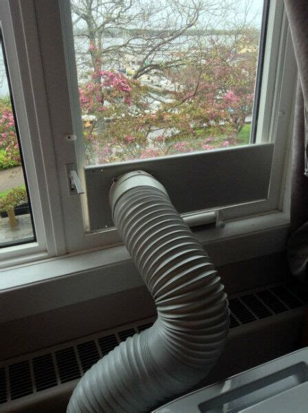 put  portable air conditioner   room   casement window heating cooling air