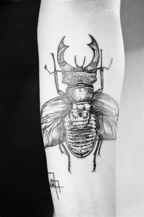black insect tattoojpg