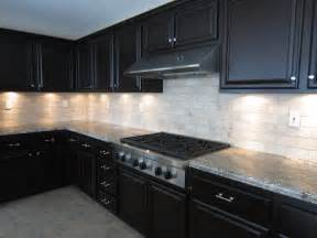 subway tile backsplash with dark cabinets kitchen idea