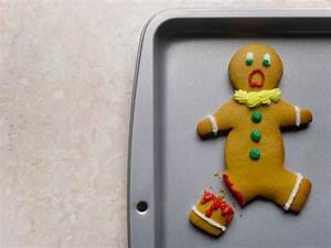 Gingerbread Man With Broken Leg On Baking Sheet Closeup ...