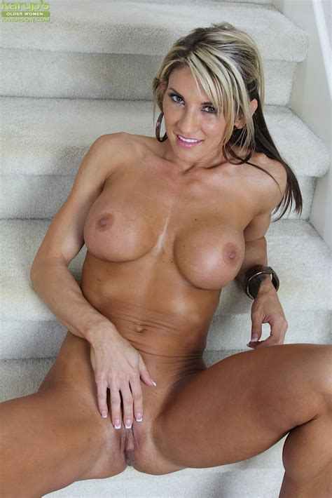 Busty Blonde Cougar Mercedes Johnson Gets Naked On The Stairs Pichunter