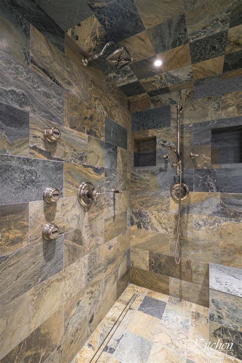large bathroom remodel  classic tub  stone tiled