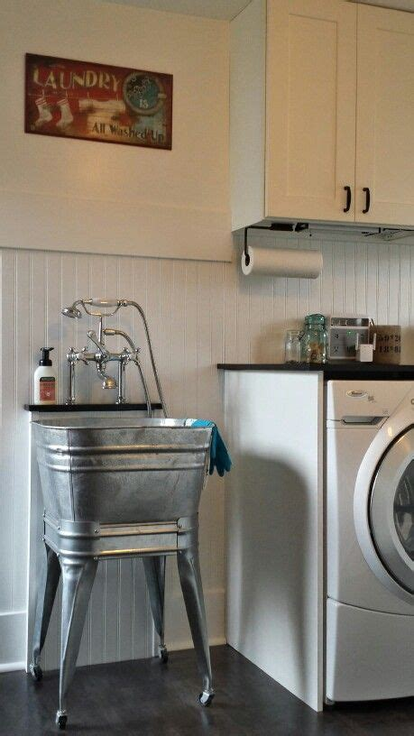 home hardware laundry tub vintage laundry mud room white walls white beadboard