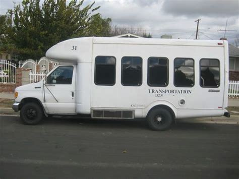buy   ford  shuttle bus race toy hauler clean
