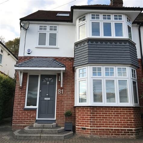 exterior 1930 s detached home before and after transformation painted hanging tiles using