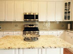khaki glass tile kitchen backsplash with white cabinets