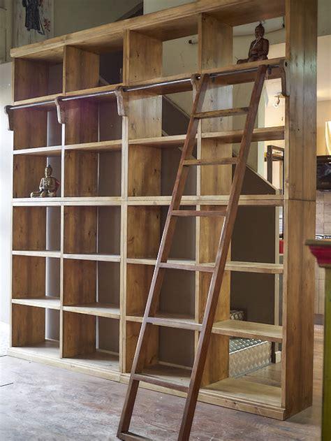 piccole librerie in legno libreria con scala legno massello india parete stile etnico