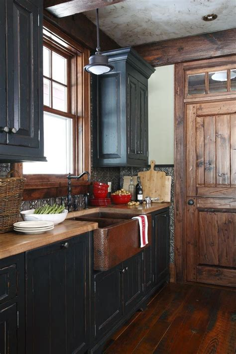 primitive painted kitchen cabinets 25 best black distressed cabinets ideas on 4416