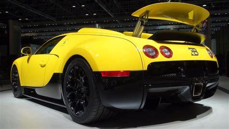 yellow bugatti veyron grand sport  dubai motorshow