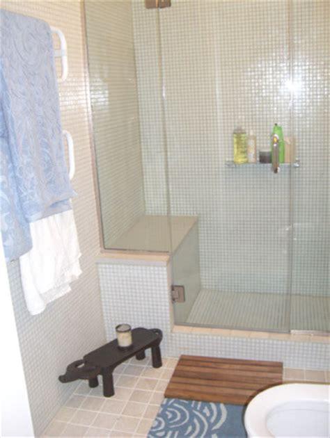 white glass mosaic tile shower surround