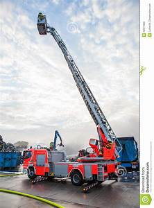 Fire Truck With A Cherry Picker Or Elevated Cage Stock