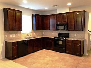Kitchen kitchen color ideas with oak cabinets and black for Best brand of paint for kitchen cabinets with outside wall art ideas