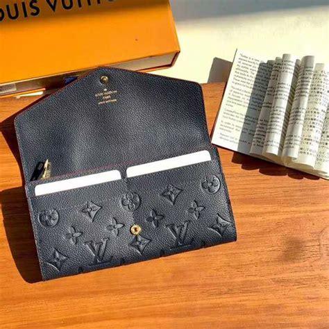 louis vuitton lv women sarah wallet monogram empreinte leather navy lulux