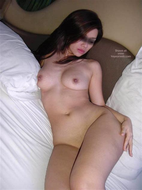 Shaved Girl Lying In Down Comforter May Voyeur Web Hall Of Fame