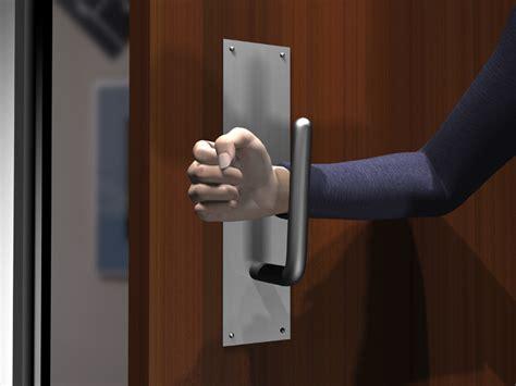 open  public restroom door   wrist  forearm