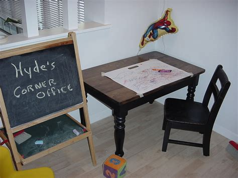 child s custom table and chair set and a chalkboard